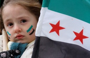 A girl with her face painted Syrian flags takes part in a protest by Syrians residing in Libya outside the Chinese embassy in Tripoli, February 6, 2012. REUTERS/Anis Mili (LIBYA - Tags: POLITICS CIVIL UNREST)